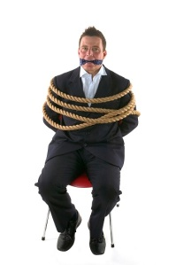 man-tied-to-chair-and-gagged